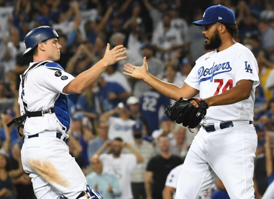 Aug 4, 2021; Los Angeles, California, USA; Los Angeles Dodgers relief pitcher Kenley Jansen (74) and catcher Will Smith (16) celebrate the 7-5 victory against the Houston Astros at Dodger Stadium. Mandatory Credit: Richard Mackson-USA TODAY Sports