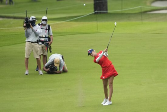 Aug 7, 2021; Tokyo, Japan; Nelly Korda (USA) hits on the 12th fairway during the final round of the women's individual stroke play of the Tokyo 2020 Olympic Summer Games at Kasumigaseki Country Club. Mandatory Credit: Michael Madrid-USA TODAY Sports