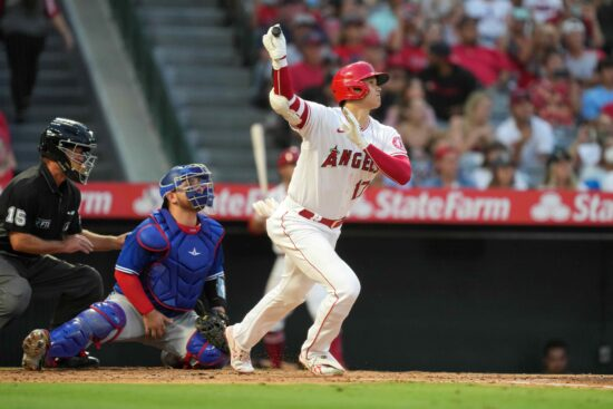 Aug 11, 2021; Anaheim, California, USA; Los Angeles Angels designated hitter Shohei Ohtani (17) follows through on a solo home run as Toronto Blue Jays catcher Alejandro Kirk (30) and umpire Ed Hickox (15) watch in the third inning  at Angel Stadium. Mandatory Credit: Kirby Lee-USA TODAY Sports