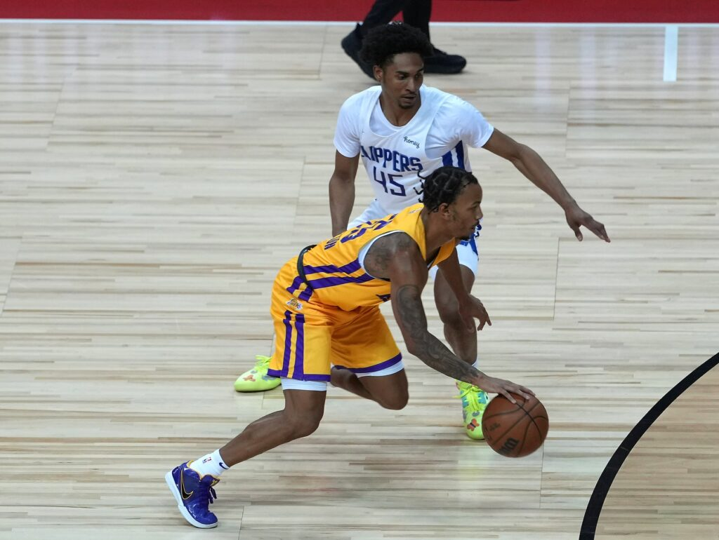 Aug 13, 2021; Las Vegas, Nevada, USA; Los Angeles Lakers guard Justin Robinson (55) dribbles past LA Clippers guard Keon Johnson (45) during an NBA Summer League game at Thomas & Mack Center. Mandatory Credit: Stephen R. Sylvanie-USA TODAY Sports