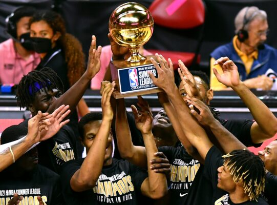 Aug 17, 2021; Las Vegas, Nevada, USA; Sacramento Kings players hoist the NBA Summer League Championship trophy after defeating the Boston Celtics 100-67 to win the Summer League final at Thomas & Mack Center. Mandatory Credit: Stephen R. Sylvanie-USA TODAY Sports