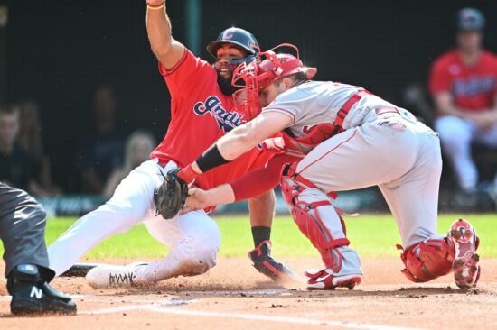 Aug 21, 2021; Cleveland, Ohio, USA; Los Angeles Angels catcher Max Stassi (33) tags out Cleveland Indians shortstop Amed Rosario (1) at home plate during the first inning at Progressive Field. Mandatory Credit: Ken Blaze-USA TODAY Sports