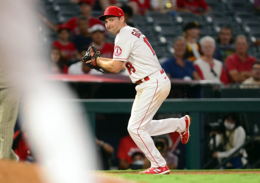 Aug 27, 2021; Anaheim, California, USA; Los Angeles Angels third baseman Phil Gosselin (13) throws to first for the out against San Diego Padres third baseman Ha-Seong Kim (7) during the third inning at Angel Stadium. Mandatory Credit: Gary A. Vasquez-USA TODAY Sports