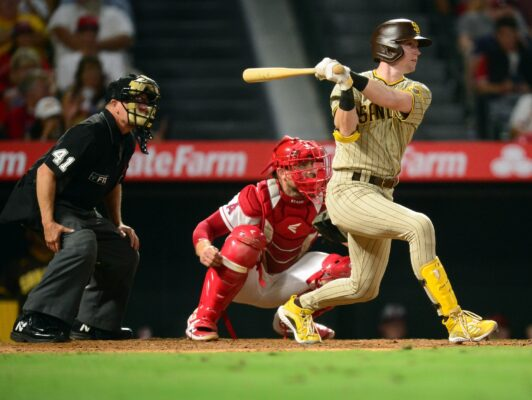 Aug 27, 2021; Anaheim, California, USA; San Diego Padres shortstop Jake Cronenworth (9) hits a single against the Los Angeles Angels during the sixth inning at Angel Stadium. Mandatory Credit: Gary A. Vasquez-USA TODAY Sports