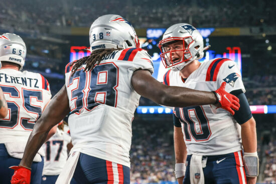 Aug 29, 2021; East Rutherford, New Jersey, USA; New England Patriots running back Rhamondre Stevenson (38) celebrates his touchdown with quarterback Mac Jones (10) during the second half against the New York Giants at MetLife Stadium. Mandatory Credit: Vincent Carchietta-USA TODAY Sports