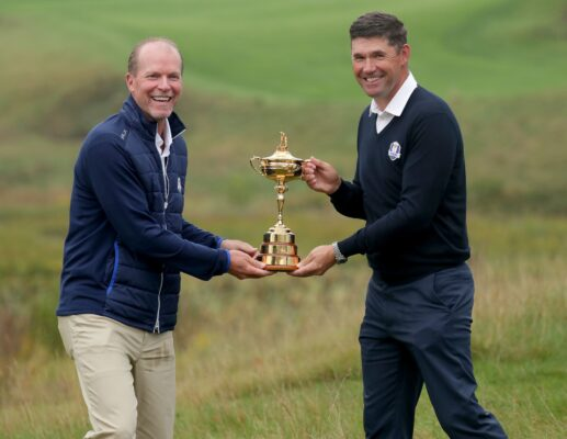 Oct 1, 2019; Haven, WI, USA; Steve Stricker, left, 2020 Ryder Cup U.S. team captain and Padraig Harrington, 2020 Ryder Cup European team captain, share a laugh as they hold the Ryder Cup trophy after the 2020 Ryder Cup Year-to-Go press conference, held at Whistling Straits golf course in Haven on Tuesday, Oct. 1, 2019. The Ryder Cup will take place Sept. 25 to 27 next year on the course owned by Kohler Co. Mandatory Credit: Mike De Sisti/Milwaukee Journal Sentinel via USA TODAY Sports