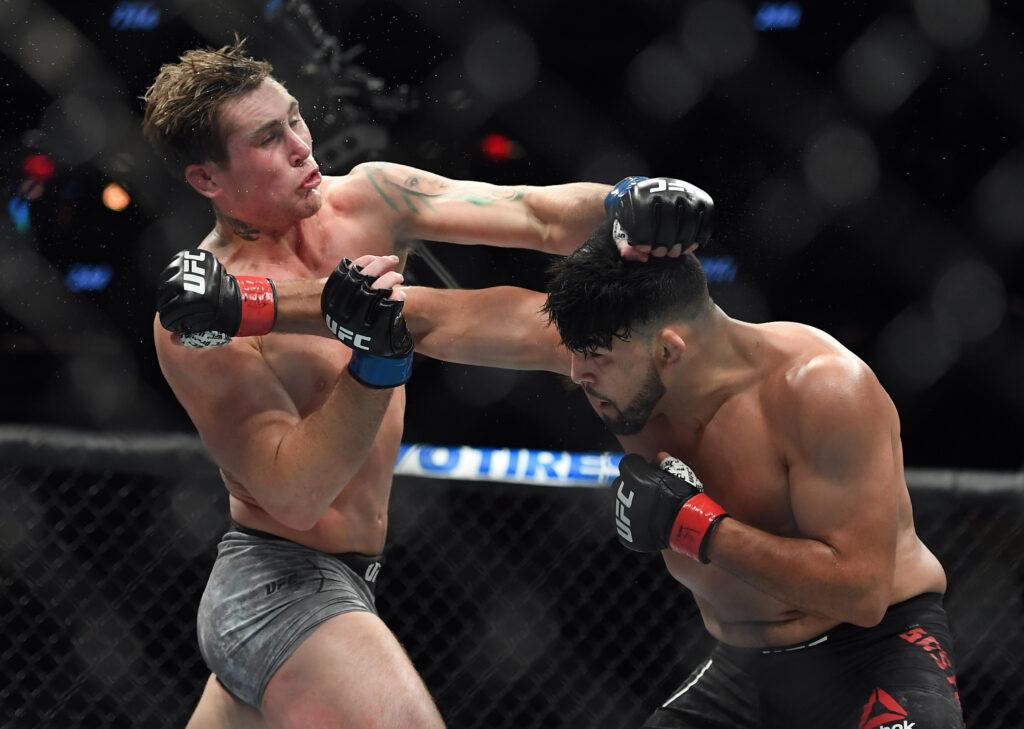 Nov 2, 2019; New York, NY, USA; Kelvin Gastelum (red gloves) fights Darren Till (blue gloves) during UFC 244 at Madison Square Garden. Mandatory Credit: Sarah Stier-USA TODAY Sports