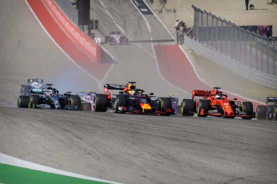 Nov 3, 2019; Austin, TX, USA; Mercedes AMG Petronas Motorsport driver Lewis Hamilton (44) of Great Britain and Aston Martin Red Bull Racing Honda driver Max Verstappen (33) of Netherlands and Scuderia Ferrari Mission Winnow driver Sebastian Vettel (5) of Germany drive into turn one during the United States Grand Prix at Circuit of the Americas. Mandatory Credit: Jerome Miron-USA TODAY Sports