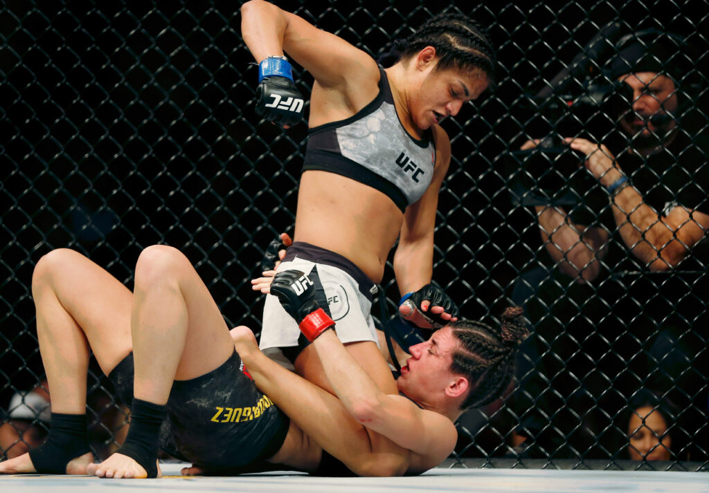 Dec 7, 2019; Washington, DC, USA; Marina Rodriguez (red gloves) fights Cynthia Calvillo (blue gloves) during UFC Fight Night at Capital One Arena. Mandatory Credit: Amber Searls-USA TODAY Sports