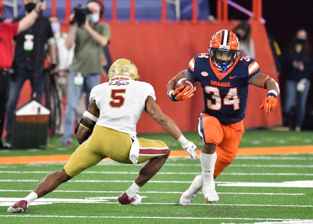 Nov 7, 2020; Syracuse, New York, USA; Syracuse Orange running back Sean Tucker (34) makes a move on Boston College Eagles defensive back Deon Jones (5) in the third quarter at the Carrier Dome. Mandatory Credit: Mark Konezny-USA TODAY Sports