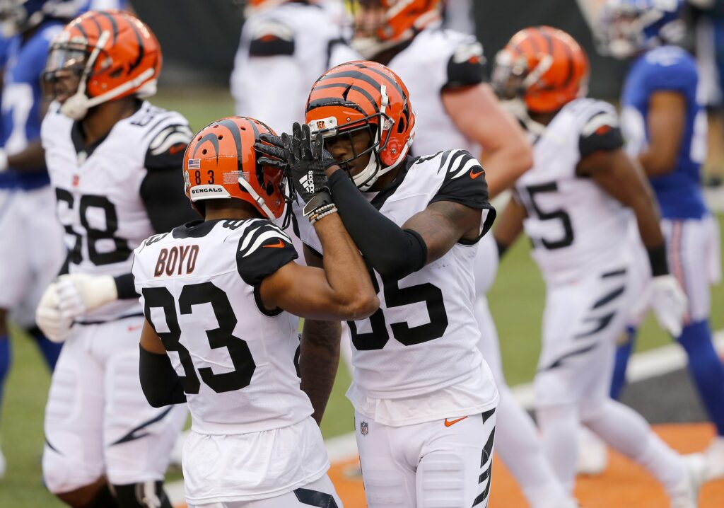 Nov 29, 2020; Cincinnati, Ohio, USA; Cincinnati Bengals wide receiver Tee Higgins (85) celebrates his touchdown with wide receiver Tyler Boyd (83) during the fourth quarter against the New York Giants at Paul Brown Stadium. Mandatory Credit: Joseph Maiorana-USA TODAY Sports