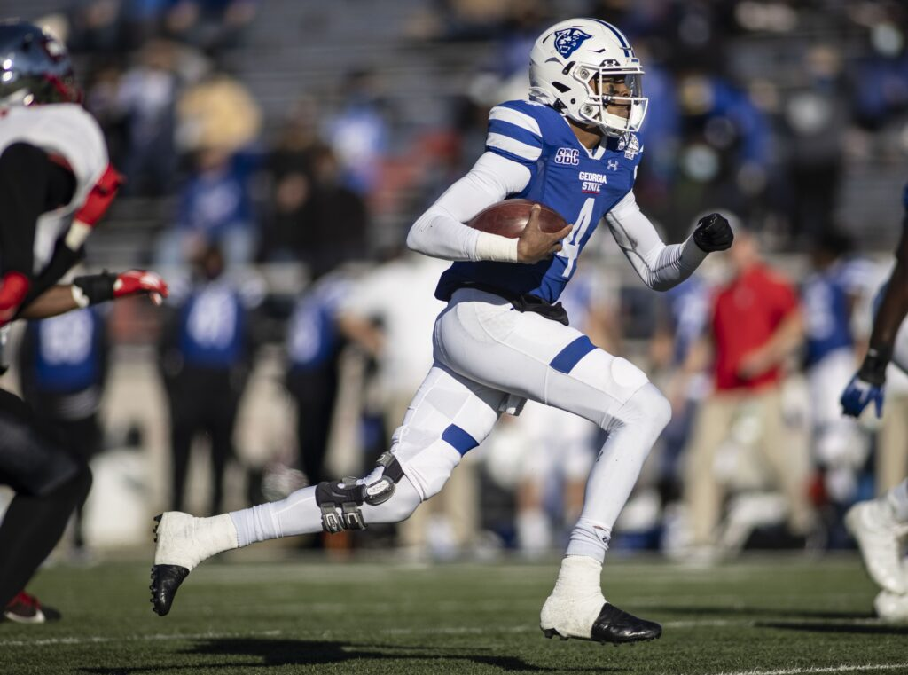 Dec 26, 2020; Mobile, AL, USA; Georgia State Panthers quarterback Cornelious Brown IV (4) runs the ball against the Western Kentucky Hilltoppers during the first quarter at Ladd-Peebles Stadium. Mandatory Credit: Vasha Hunt-USA TODAY Sports