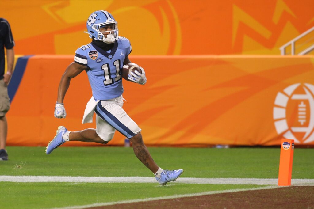 Jan 2, 2021; Miami Gardens, FL, USA; North Carolina Tar Heels wide receiver Josh Downs (11) runs with the football for a touchdown against the Texas A&M Aggies in the fourth quarter of the game at Hard Rock Stadium. Mandatory Credit: Sam Navarro-USA TODAY Sports