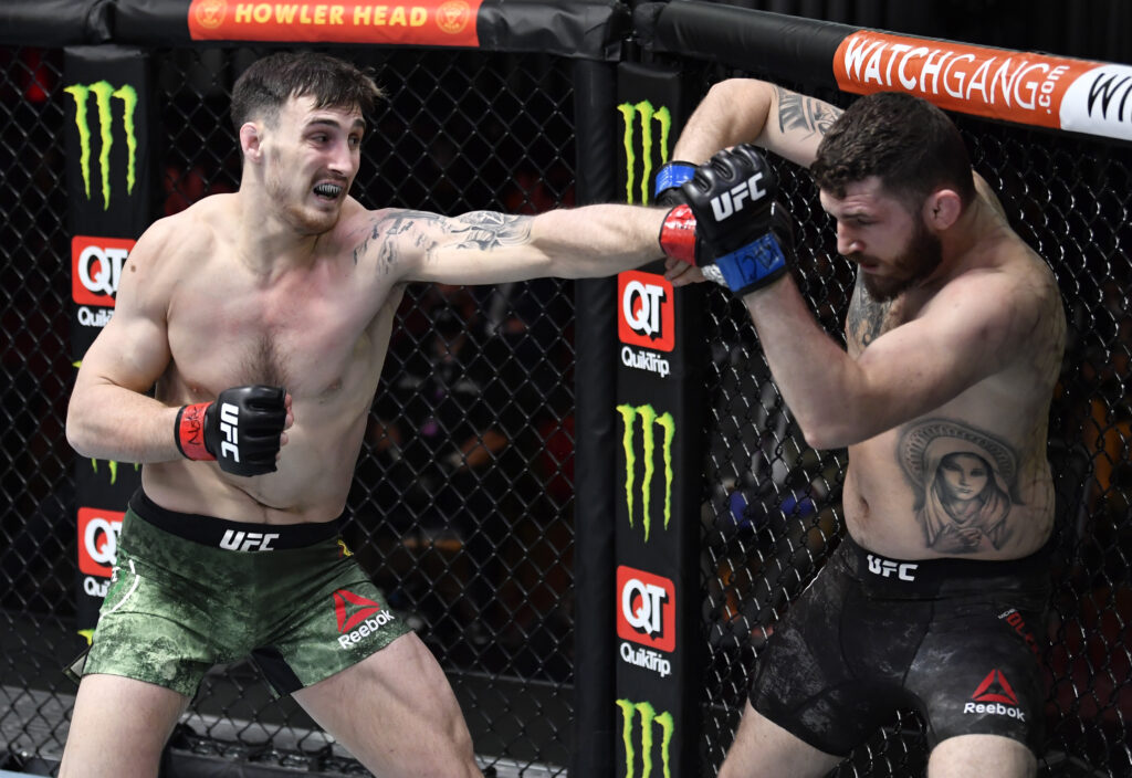 Mar 27, 2021; Las Vegas, NV, USA;  Modestas Bukauskas of Lithuania punches Michal Oleksiejczuk of Poland in their light heavyweight fight during the UFC 260 event at UFC APEX on March 27, 2021 in Las Vegas, Nevada.   Mandatory Credit: Jeff Bottari/Handout Photo via USA TODAY Sports