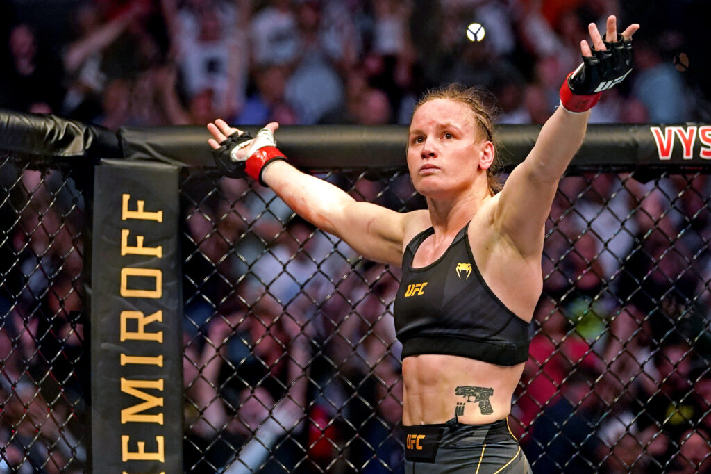 Apr 24, 2021; Jacksonville, Florida, USA; Valentina Shevchenko (Red Gloves) fights Jessica Andrade (Blue Gloves) during UFC 261 at VyStar Veterans Memorial Arena. Mandatory Credit: Jasen Vinlove-USA TODAY Sports