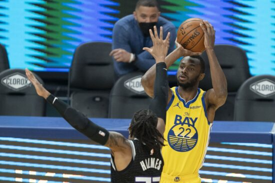 April 25, 2021; San Francisco, California, USA; Golden State Warriors forward Andrew Wiggins (22, right) shoots the basketball against Sacramento Kings center Richaun Holmes (22, left) during the first quarter at Chase Center. Mandatory Credit: Kyle Terada-USA TODAY Sports