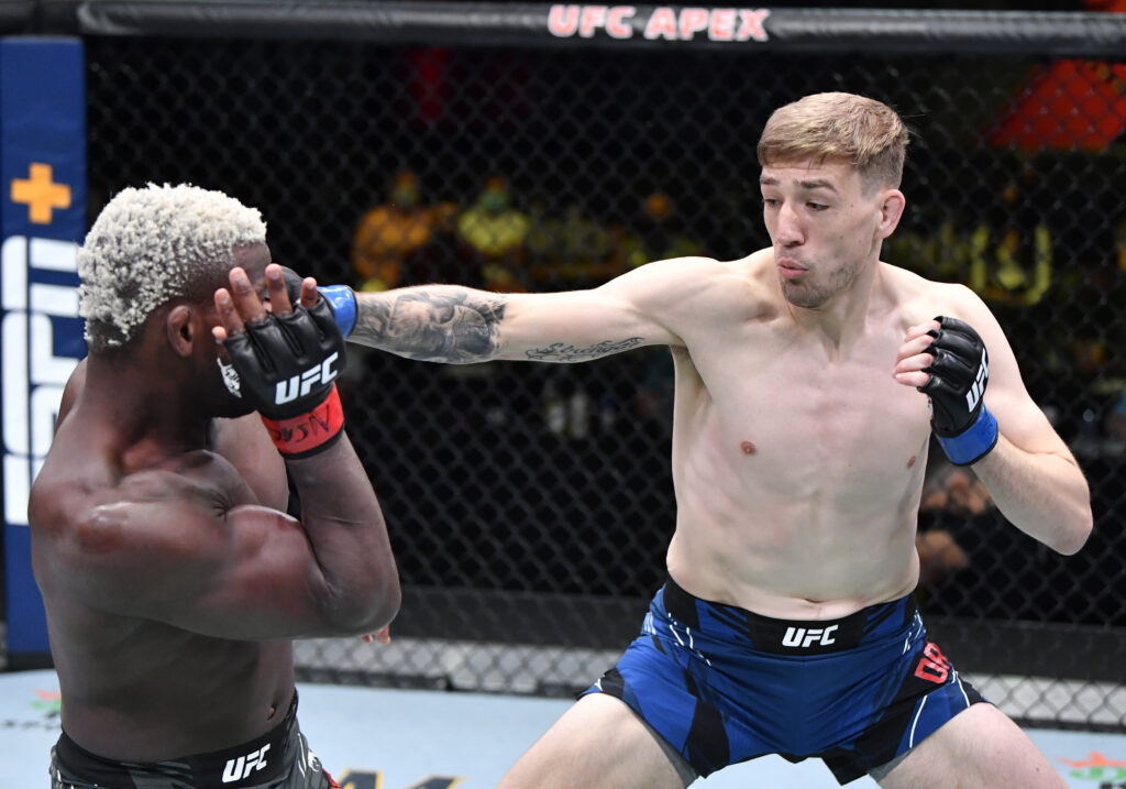 May 8, 2021; Las Vegas, NV, USA;  Kyle Daukaus punches Phil Hawes in a middleweight fight during the UFC Fight Night event at UFC APEX on May 08, 2021 in Las Vegas, Nevada.  Mandatory Credit: Chris Unger/Handout Photo via USA TODAY Sports