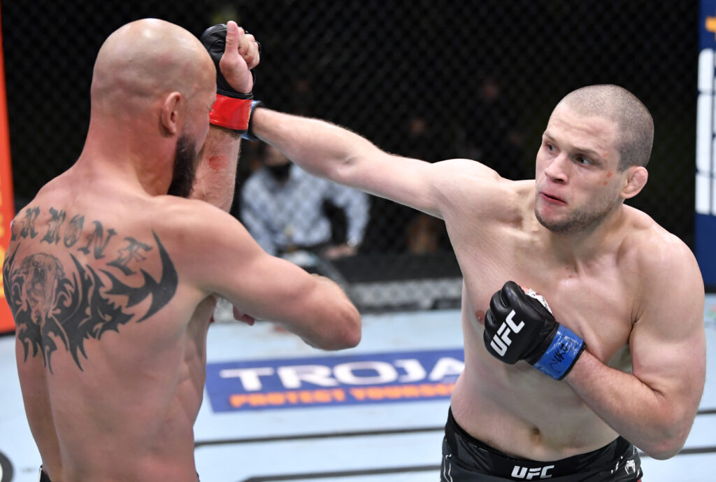 May 8, 2021; Las Vegas, NV, USA;   Alex Morono punches Donald Cerrone in a welterweight fight during the UFC Fight Night event at UFC APEX on May 08, 2021 in Las Vegas, Nevada. Mandatory Credit: Chris Unger/Handout Photo via USA TODAY Sports