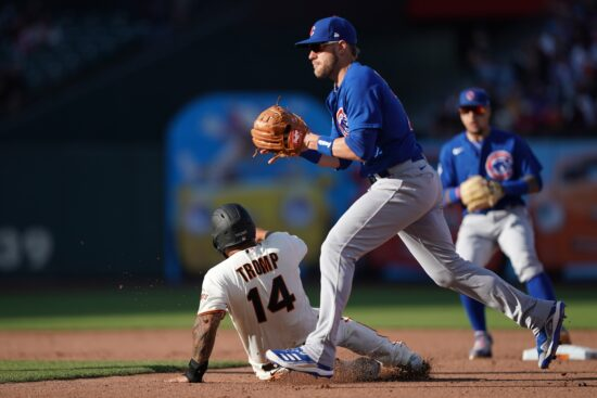 Jun 5, 2021; San Francisco, California, USA; San Francisco Giants catcher Chadwick Tromp (14) slides to elude a tag by Chicago Cubs second baseman Patrick Wisdom (16) during the sixth inning at Oracle Park. Mandatory Credit: Darren Yamashita-USA TODAY Sports