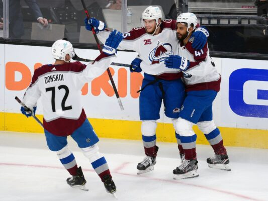 Jun 10, 2021; Las Vegas, Nevada, USA; Colorado Avalanche left wing Andre Burakovsky (95) celebrates with right wing Joonas Donskoi (72) and center Pierre-Edouard Bellemare (41) his goal scored against the Vegas Golden Knights during the second period in game six of the second round of the 2021 Stanley Cup Playoffs at T-Mobile Arena. Mandatory Credit: Gary A. Vasquez-USA TODAY Sports