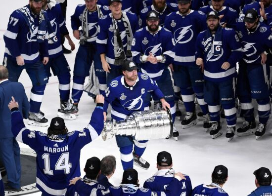 Jul 7, 2021; Tampa, Florida, USA; Tampa Bay Lightning center Steven Stamkos (91) hoists the Stanley Cup after the Lightning defeated the Montreal Canadiens 1-0 in game five to win the 2021 Stanley Cup Final at Amalie Arena. Mandatory Credit: Douglas DeFelice-USA TODAY Sports