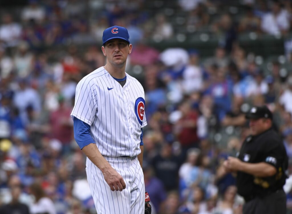 Aug 12, 2021; Chicago, Illinois, USA;  Chicago Cubs starting pitcher Kyle Hendricks (28)  looks on after Milwaukee Brewers catcher Manny Pina (9) hits a grand slam  during the fifth inning at Wrigley Field. Mandatory Credit: Matt Marton-USA TODAY Sports