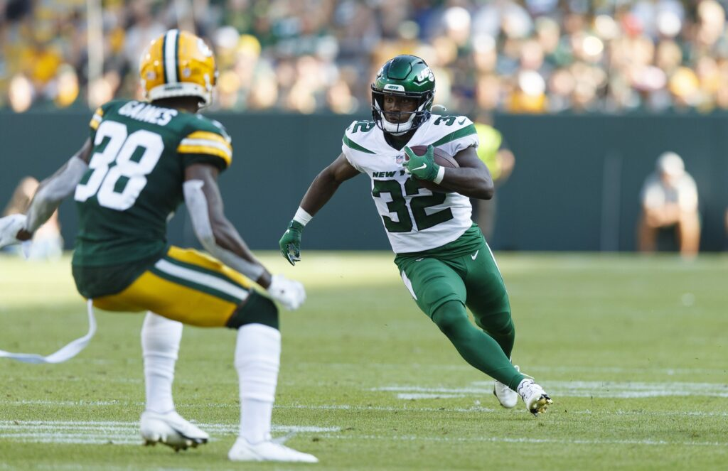 Aug 21, 2021; Green Bay, Wisconsin, USA;  New York Jets running back Michael Carter (32) rushes with the football during the third quarter against the Green Bay Packers at Lambeau Field. Mandatory Credit: Jeff Hanisch-USA TODAY Sports