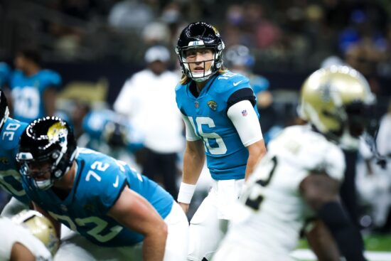 Aug 23, 2021; New Orleans, Louisiana, USA; Jacksonville Jaguars quarterback Trevor Lawrence (16) audibles against the New Orleans Saints defensive line during the first half at Caesars Superdome. Mandatory Credit: Stephen Lew-USA TODAY Sports