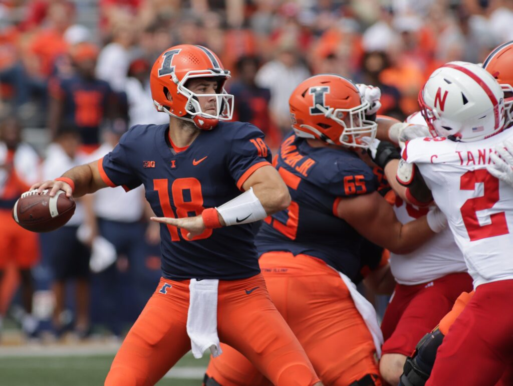 Aug 28, 2021; Champaign, Illinois, USA;  Illinois quarterback Brandon Peters (18) throws a pass in the first half against the Nebraska Cornhuskers at Memorial Stadium. Mandatory Credit: Ron Johnson-USA TODAY Sports