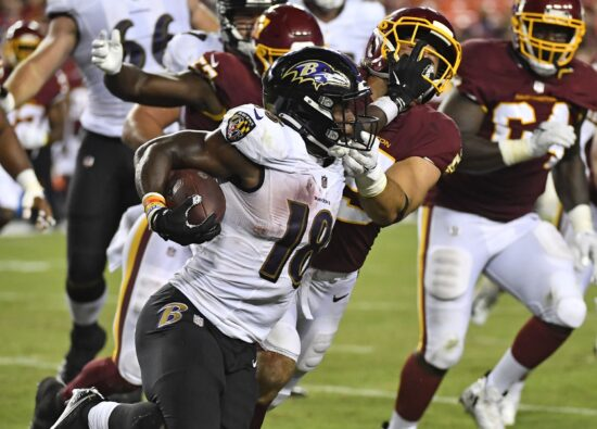 Aug 28, 2021; Landover, Maryland, USA; Baltimore Ravens running back Nate McCrary (18) carries the ball against the Washington Football Team during the second half at FedExField. Mandatory Credit: Brad Mills-USA TODAY Sports
