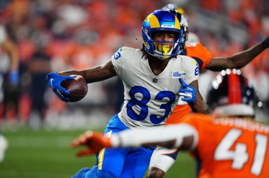 Aug 28, 2021; Denver, Colorado, USA; Los Angeles Rams wide receiver Trishton Jackson (83) carries the ball in the second half against the Denver Broncos during a preseason game at Empower Field at Mile High. Mandatory Credit: Ron Chenoy-USA TODAY Sports