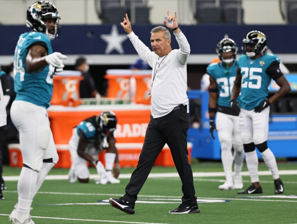 Aug 29, 2021; Arlington, Texas, USA; Jacksonville Jaguars head coach Urban Meyer directs his team prior to the game against the Dallas Cowboys at AT&T Stadium. Mandatory Credit: Matthew Emmons-USA TODAY Sports