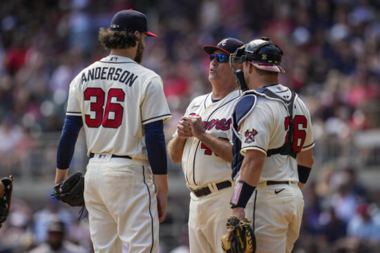 Aug 29, 2021; Cumberland, Georgia, USA; Atlanta Braves manager Brian Snitker (43) removes starting pitcher Ian Anderson (36) from the game against the San Francisco Giants during the sixth inning at Truist Park. Mandatory Credit: Dale Zanine-USA TODAY Sports