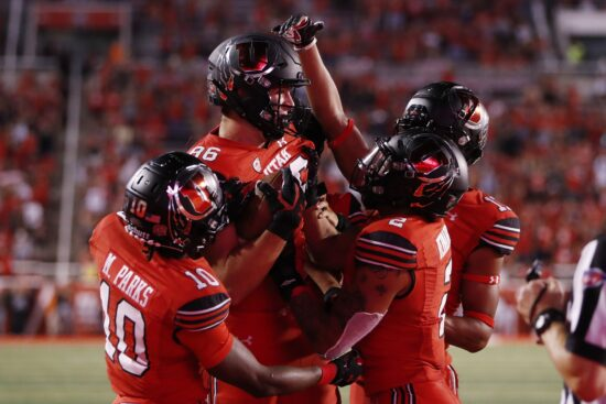 Sep 2, 2021; Salt Lake City, Utah, USA;  Utah Utes tight end Dalton Kincaid (86) is congratulated for his fourth quarter touchdown against the Weber State Wildcats at Rice-Eccles Stadium. Mandatory Credit: Jeffrey Swinger-USA TODAY Sports