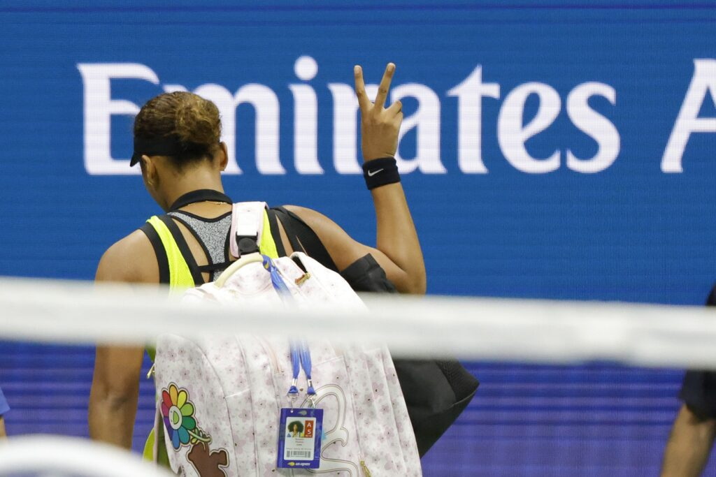 Sep 3, 2021; Flushing, NY, USA; Naomi Osaka of Japan gestures a peace sign to the crowd while leaving the court after her match against Leylah Annie Fernandez of Canada (not pictured) on day five of the 2021 U.S. Open tennis tournament at USTA Billie Jean King National Tennis Center. Mandatory Credit: Geoff Burke-USA TODAY Sports