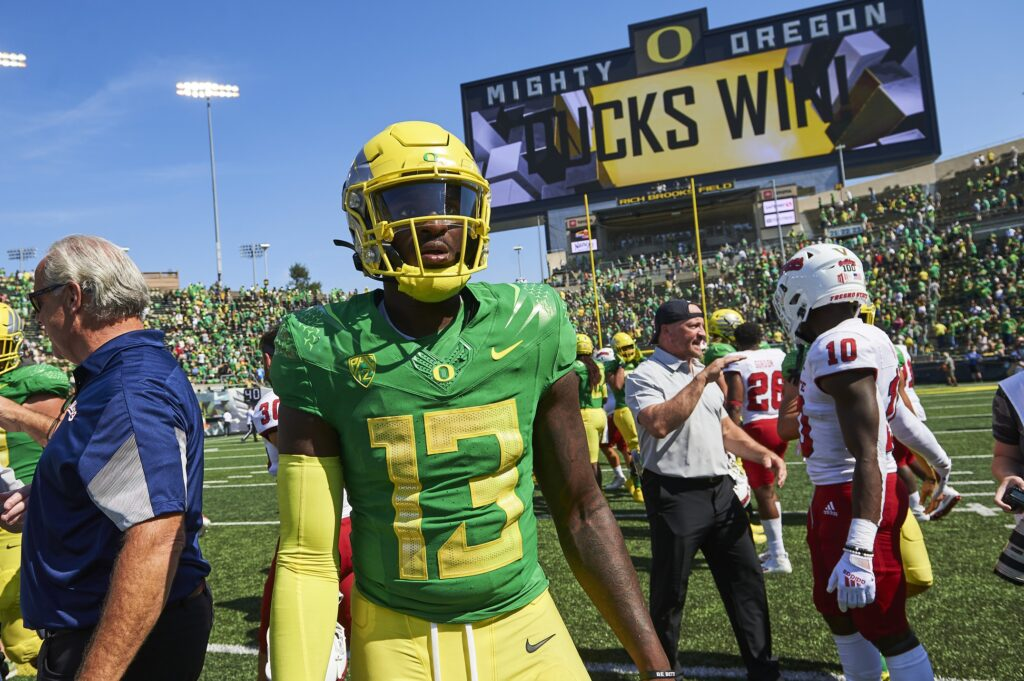 Sep 4, 2021; Eugene, Oregon, USA; Oregon Ducks quarterback Anthony Brown (13) walks off the field after a game against the Fresno State Bulldogs at Autzen Stadium. The Ducks won the game 31-24. Mandatory Credit: Troy Wayrynen-USA TODAY Sports