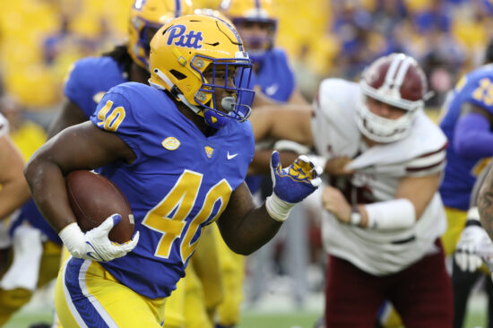 Sep 4, 2021; Pittsburgh, Pennsylvania, USA;  Pittsburgh Panthers running back Daniel Carter (40) runs the ball against the Massachusetts Minutemen during the fourth quarter at Heinz Field. Pittsburgh won 51-7. Mandatory Credit: Charles LeClaire-USA TODAY Sports