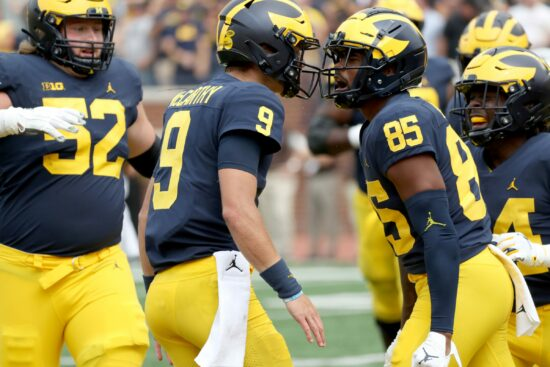 Michigan Wolverines quarterback J.J. McCarthy (9) celebrates with wide receiver Daylen Baldwin (85) after throwing Baldwin a touchdown pass during second half action Saturday, Sept. 4, 2021.Mich West
