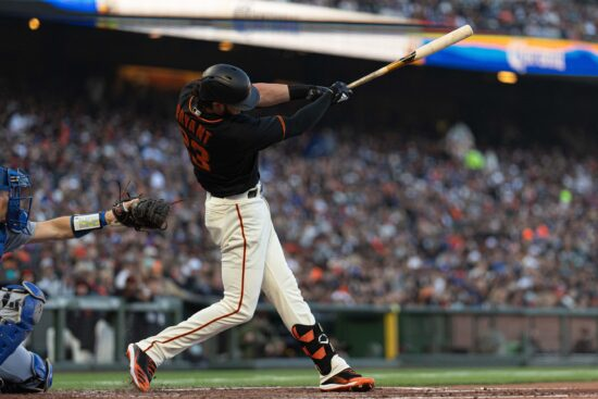 Sep 4, 2021; San Francisco, California, USA;  San Francisco Giants third baseman Kris Bryant (23) hits a single during the first inning against the Los Angeles Dodgers at Oracle Park. Mandatory Credit: Stan Szeto-USA TODAY Sports