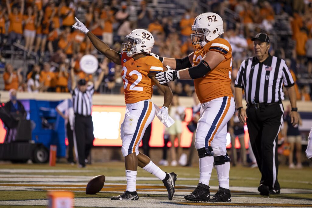 Sep 4, 2021; Charlottesville, Virginia, USA; Virginia Cavaliers running back Ronnie Walker Jr. (32) celebrates with guard Joe Bissinger (52) after scoring a touchdown against William & Mary Tribe during the second half at Scott Stadium. Mandatory Credit: Scott Taetsch-USA TODAY Sports