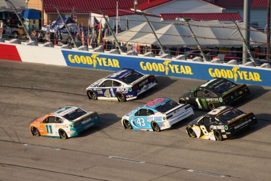 Sep 5, 2021; Darlington, South Carolina, USA; NASCAR Cup Series driver Denny Hamlin (11) and Kevin Harvick (4) race ahead of Erik Jones (43), Kurt Busch (1) and Tyler Reddick (8) during the Cook Out Southern 500 at Darlington Raceway. Mandatory Credit: Jasen Vinlove-USA TODAY Sports