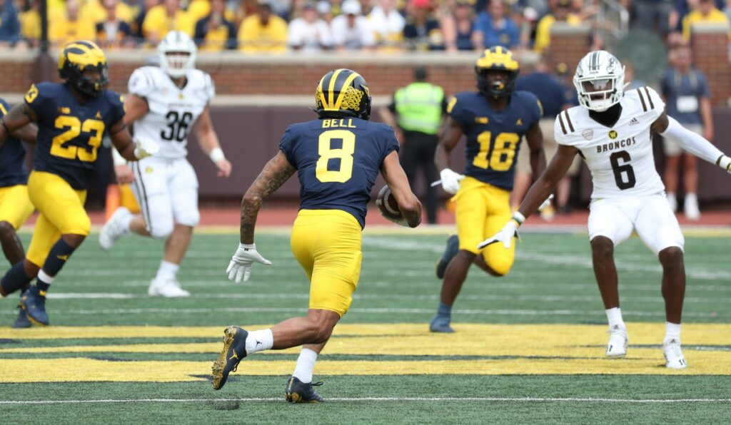 Michigan Wolverines wide receiver Ronnie Bell (8) returned this punt 31 yards vs. the Western Michigan Broncos before doing down with an injury immediately after the play Saturday, Sept. 4, 2021 at Michigan Stadium.  Mich West