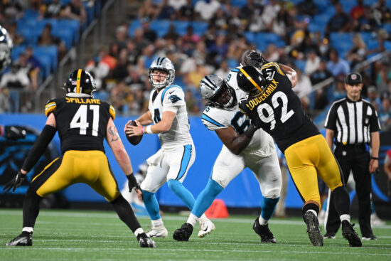 Aug 27, 2021; Charlotte, North Carolina, USA;  Carolina Panthers quarterback Sam Darnold (14) looks to pass as Pittsburgh Steelers linebacker Robert Spillane (41) and defensive end Isaiahh Loudermilk (92) pressure in the second quarter at Bank of America Stadium. Mandatory Credit: Bob Donnan-USA TODAY Sports