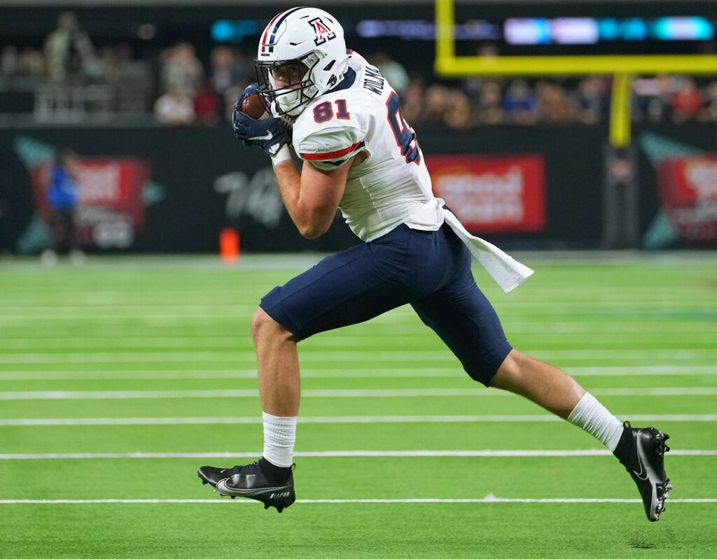 Sep 4, 2021; Paradise, Nevada, USA; Arizona Wildcats tight end Bryce Wolma (81) looks upfield after making a catch against the Brigham Young Cougars at Allegiant Stadium. Mandatory Credit: Stephen R. Sylvanie-USA TODAY Sports