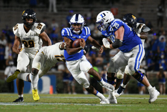 Sep 10, 2021; Durham, North Carolina, USA; Duke Blue Devils quarterback Jordan Moore (8) runs against the North Carolina A&T Aggies during the fourth quarter at Wallace Wade Stadium. Mandatory Credit: William Howard-USA TODAY Sports