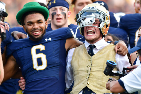 Sep 11, 2021; South Bend, Indiana, USA; Notre Dame Fighting Irish cornerback Clarence Lewis (6) and the Notre Dame Leprechaun celebrate after Notre Dame defeated the Toledo Rockets at Notre Dame Stadium. Mandatory Credit: Matt Cashore-USA TODAY Sports