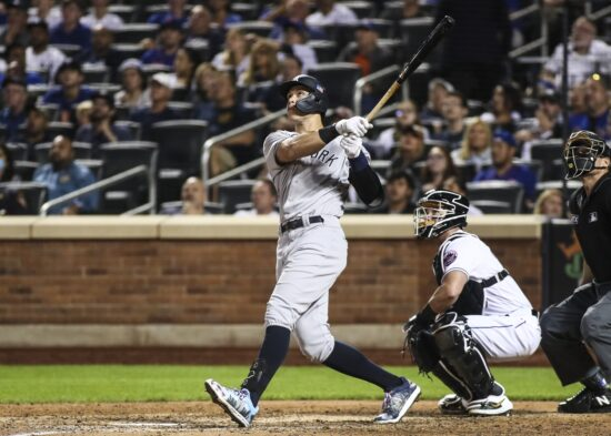 Sep 11, 2021; New York City, New York, USA;New York Yankees right fielder Aaron Judge (99) hits a two run home run in the eighth inning against the New York Mets at Citi Field. Mandatory Credit: Wendell Cruz-USA TODAY Sports