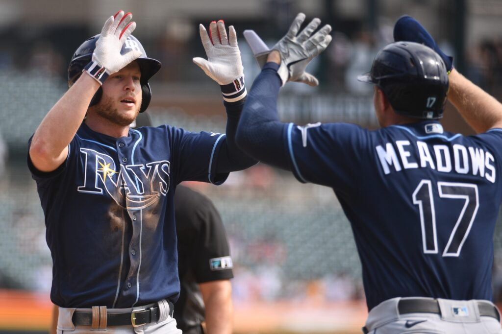 Sep 12, 2021; Detroit, Michigan, USA; Tampa Bay Rays center fielder Brett Phillips (35) celebrates his home run with left fielder Austin Meadows (17) during the eighth inning against the Detroit Tigers at Comerica Park. Mandatory Credit: Tim Fuller-USA TODAY Sports