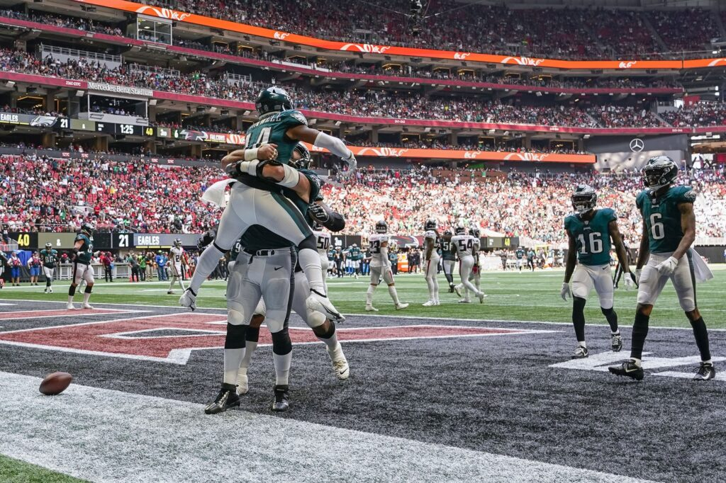 Sep 12, 2021; Atlanta, Georgia, USA; Philadelphia Eagles running back Kenneth Gainwell (14) reacts with teammates after scoring a touchdown against the Atlanta Falcons defense at Mercedes-Benz Stadium. Mandatory Credit: Dale Zanine-USA TODAY Sports
