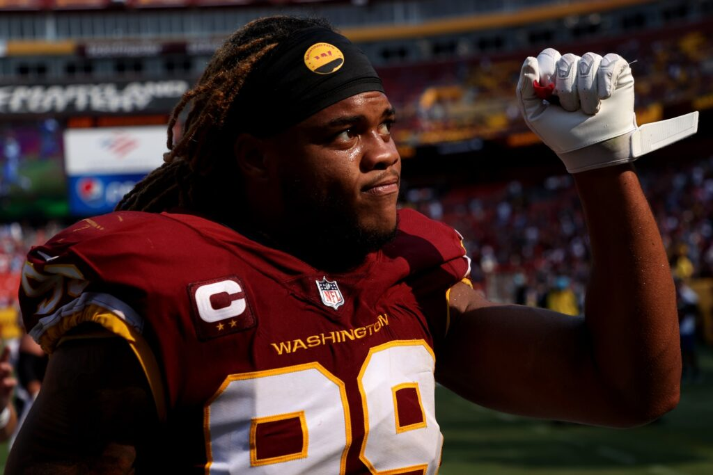 Sep 12, 2021; Landover, Maryland, USA; Washington Football Team defensive end Chase Young (99) gestures to fans while leaving the field after the game against the Los Angeles Chargers at FedExField. Mandatory Credit: Geoff Burke-USA TODAY Sports